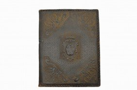 13: AN ITALIAN EMBOSSED AND TOOLED LEATHER DESK FOLIO L