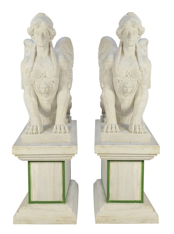 21: A PAIR OF WHITE CARRARA MARBLE HAND-CARVED SPHINXES