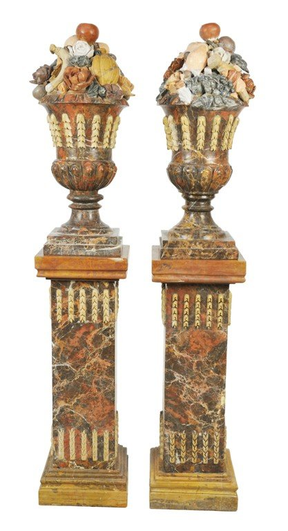 26: A PAIR OF MARBLE FRUIT URNS ON PEDESTALS Italy, 20t
