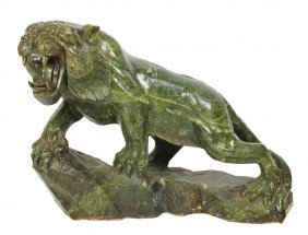 A FINELY DETAILED HAND-CARVED MARBLE TIGER China, 2