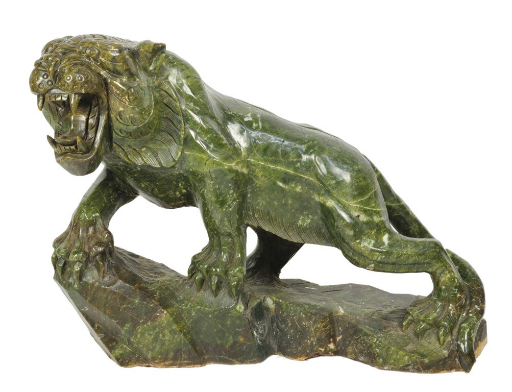 34: A FINELY DETAILED HAND-CARVED MARBLE TIGER China, 2
