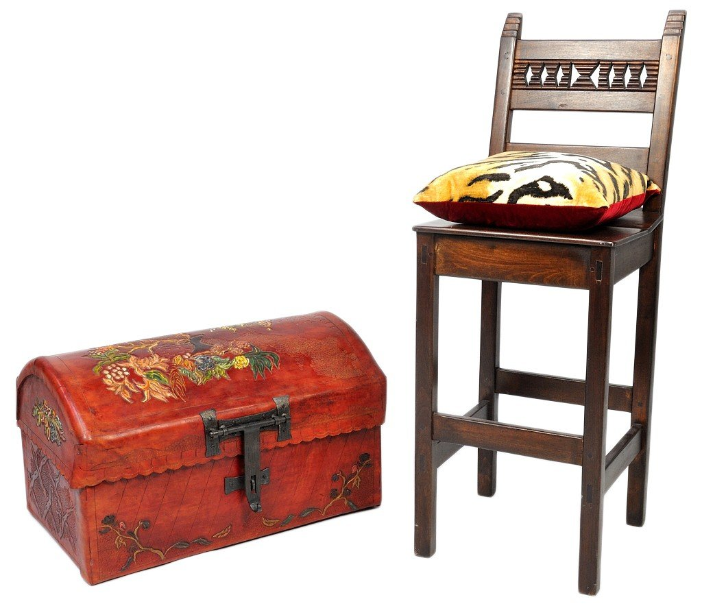 24: A DECORATED LEATHER TRUNK AND PILLOW WITH WOOD BAR