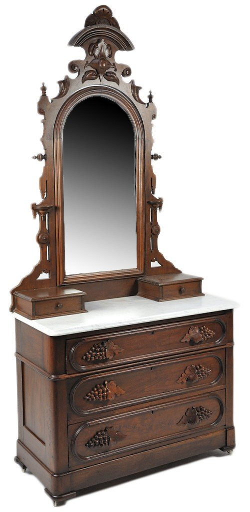 7: AN ITALIAN MAHOGANY DRESSER WITH MARBLE TOP AND PIVO
