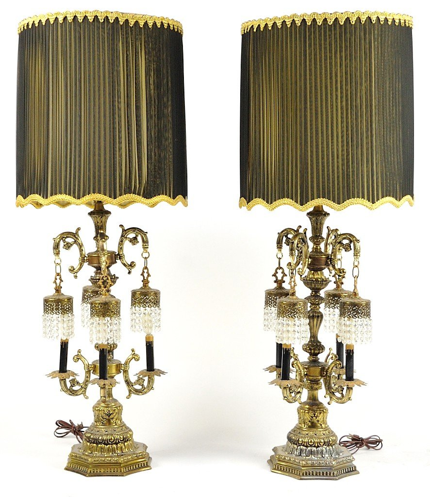 63: A PAIR OF LOUIS XVI STYLE FOUR LIGHT BRASS LAMPS WI