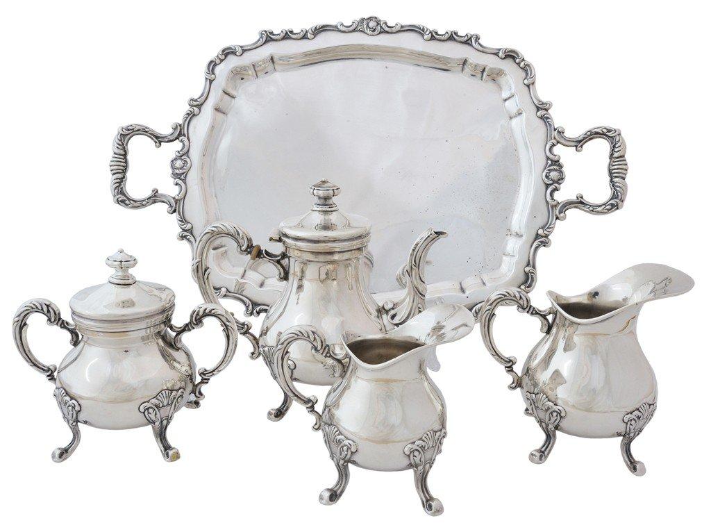 9: A FIVE-PIECE PERUVIAN STERLING SILVER TEA SET, 20th