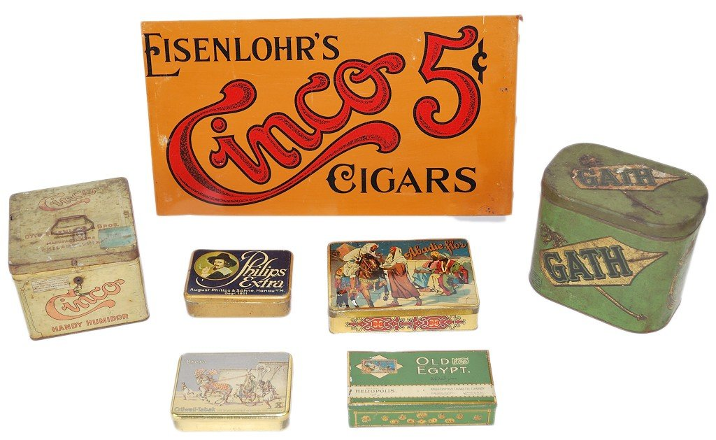 17: A GROUP OF ANTIQUE TOBACCO ADVERTISING TINS