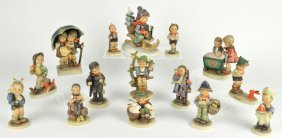 A COLLECTION OF 15 HUMMEL FIGURINES