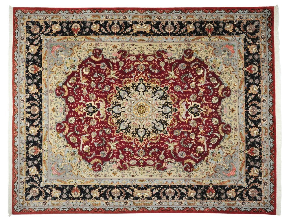63: A PERSIAN TABRIZ SILK AND WOOL RUG Central Persia,