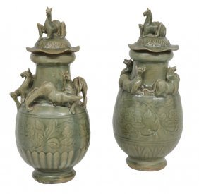 A COMPANION PAIR OF CHINESE CELADON CERAMIC LIDDED