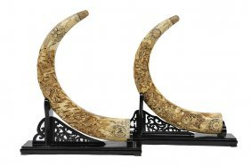 A COMPANION PAIR OF CARVED BONE TUSKS ON STANDS Ch
