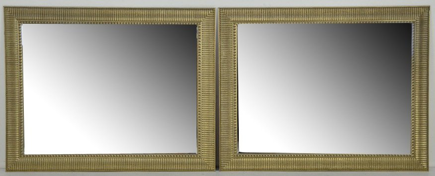 8: A PAIR OF LARGE RECTANGULAR SILVER GILT MIRRORS