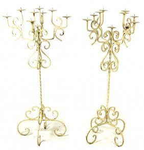 A PAIR OF WROUGHT IRON NINE LIGHT CATHEDRAL STYLE C