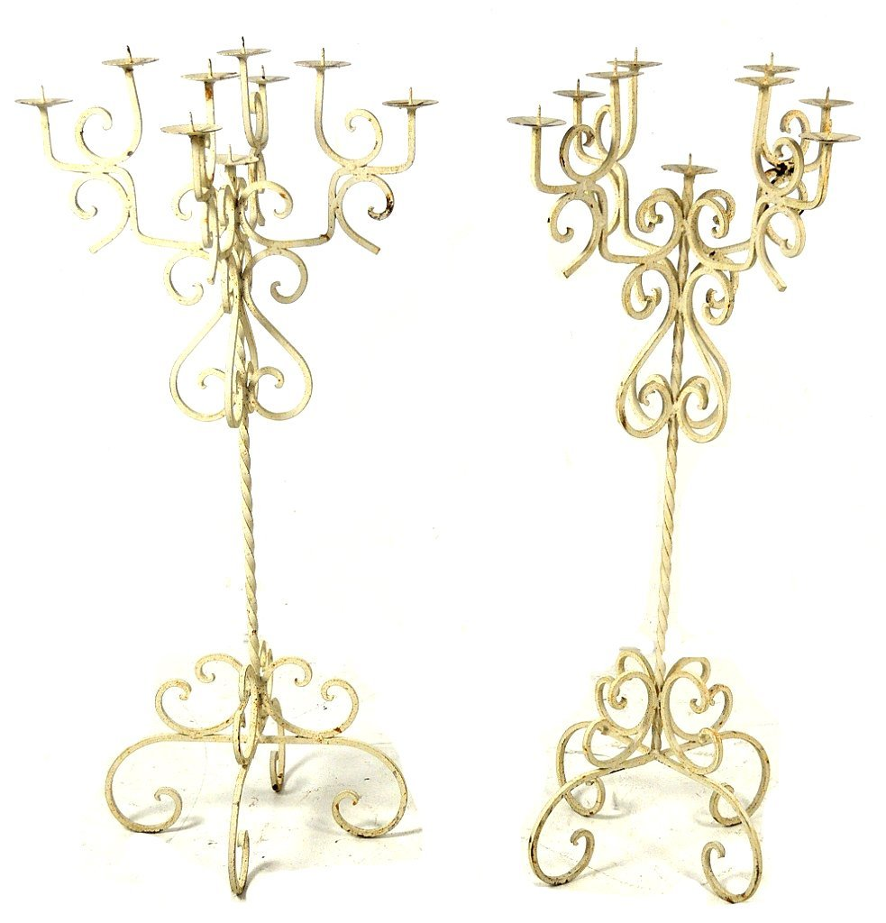 25: A PAIR OF WROUGHT IRON NINE LIGHT CATHEDRAL STYLE C