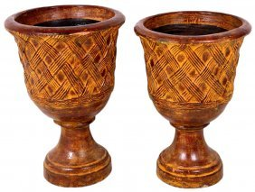 A PAIR OF URN SHAPED TERRA COTTA PLANTERS