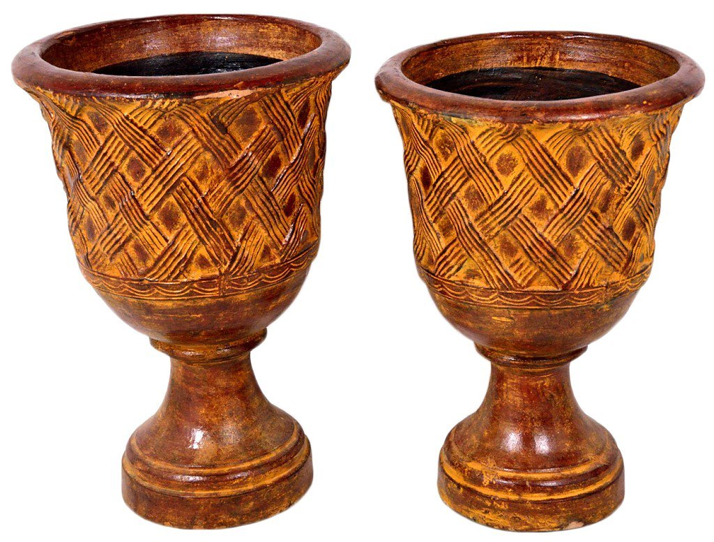 34: A PAIR OF URN SHAPED TERRA COTTA PLANTERS