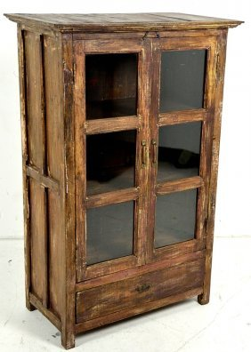 A SMALL PRIMITIVE TWO DOOR CABINET