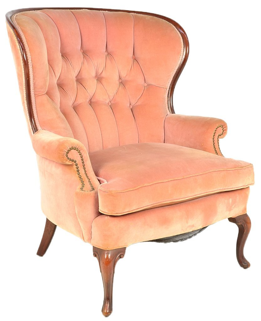 130: A LARGE SCALE MAHOGANY WING CHAIR