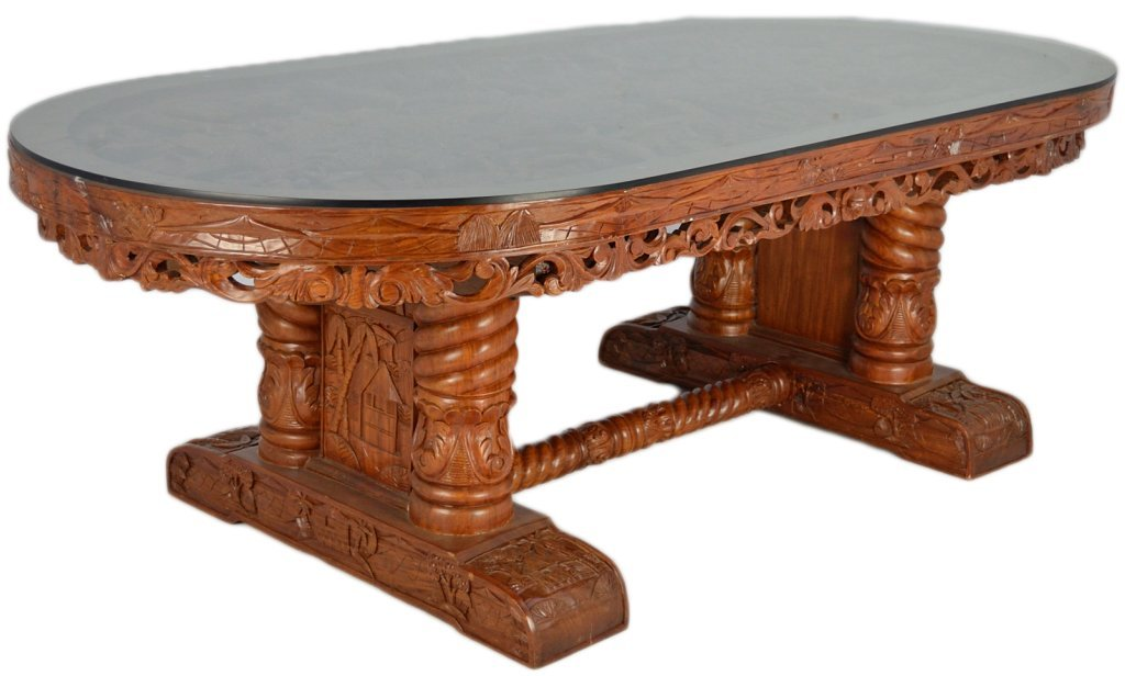 181: A LARGE HAND CARVED PHILLIPINE MAHOGANY DINING TAB