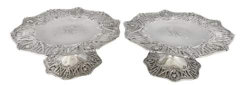 2: A DELICATE PAIR OF STERLING SILVER FOOTED COOKIE PLA