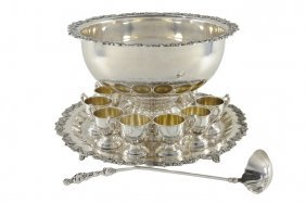 17: A 13 PIECE SILVER PLATED LARGE PUNCH BOWL SET AND T