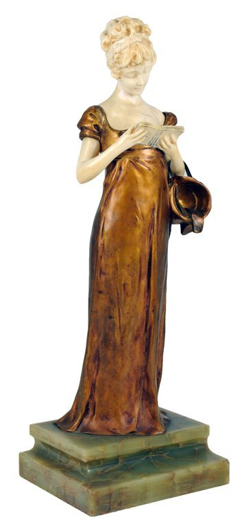 129: AN UNUSUAL BRONZE AND IVORY STATUE OF A COURTLY YO