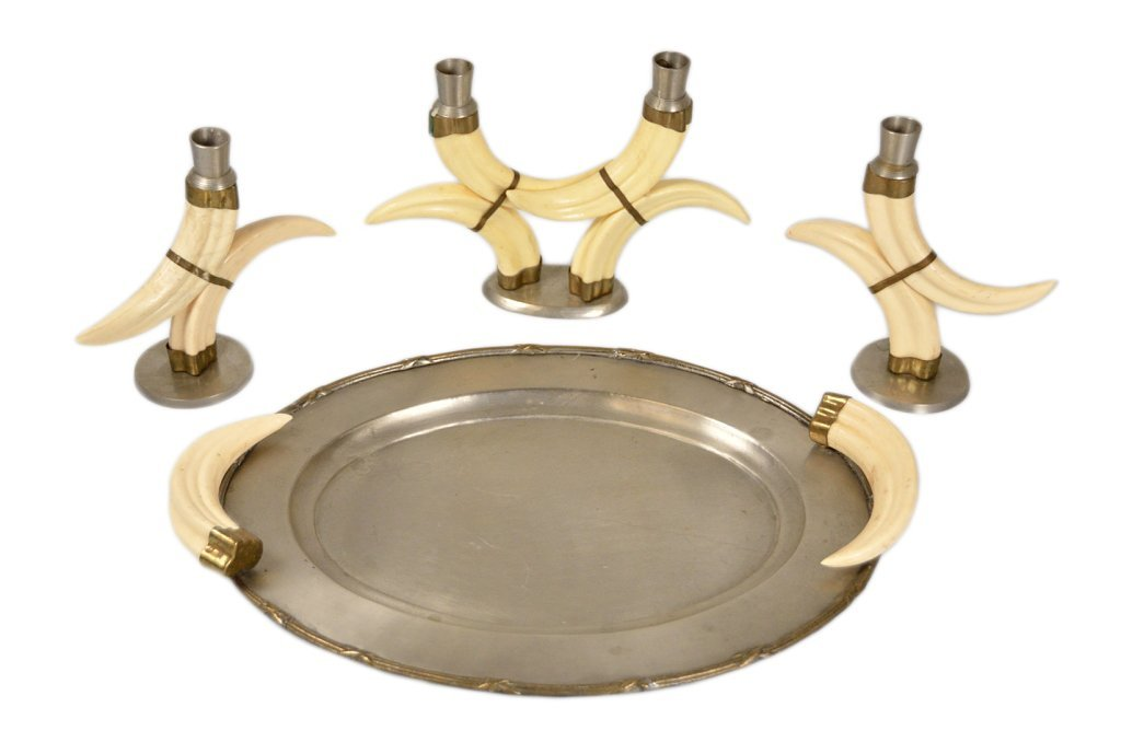 16: A SET OF FOUR PEWTER AND FAUX HORN TABLE ITEMS