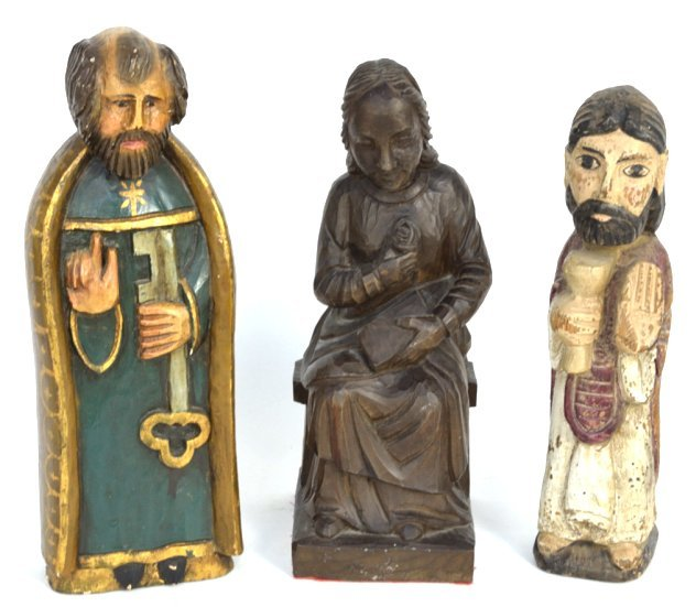 19: A GROUP OF THREE HAND CARVED SANTOS FIGURES