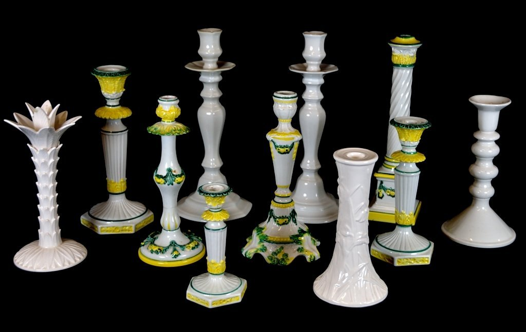 3: A GROUPING OF DECORATIVE CERAMIC CANDLESTICKS