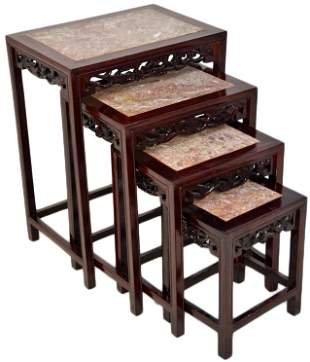 A SET OF ASIAN STYLE NESTING TABLES WITH STONE TOPS
