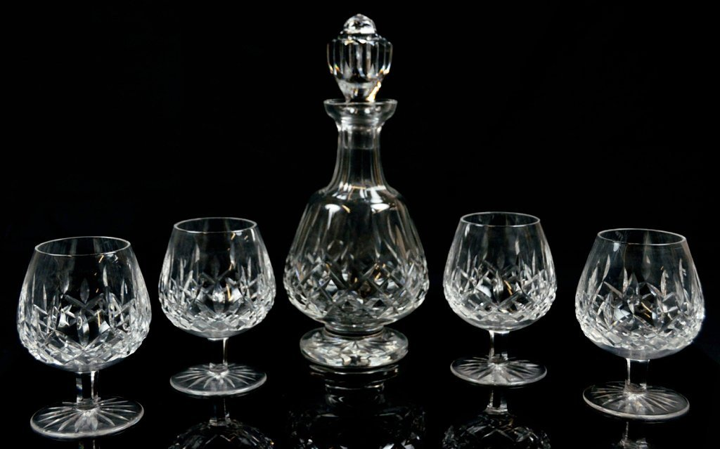 17: A FIVE-PIECE WATERFORD CRYSTAL BRANDY SET