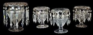 A GROUP OF FOUR CUT CRYSTAL VASES WITH PRISMS