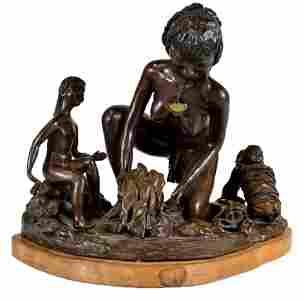 65: A PATINATED BRONZE SCULPTURE OF A SINAGUAN FAMILY