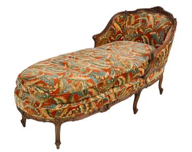 92: A LOUIS XV STYLE CARVED WALNUT CHAISE LONGUE