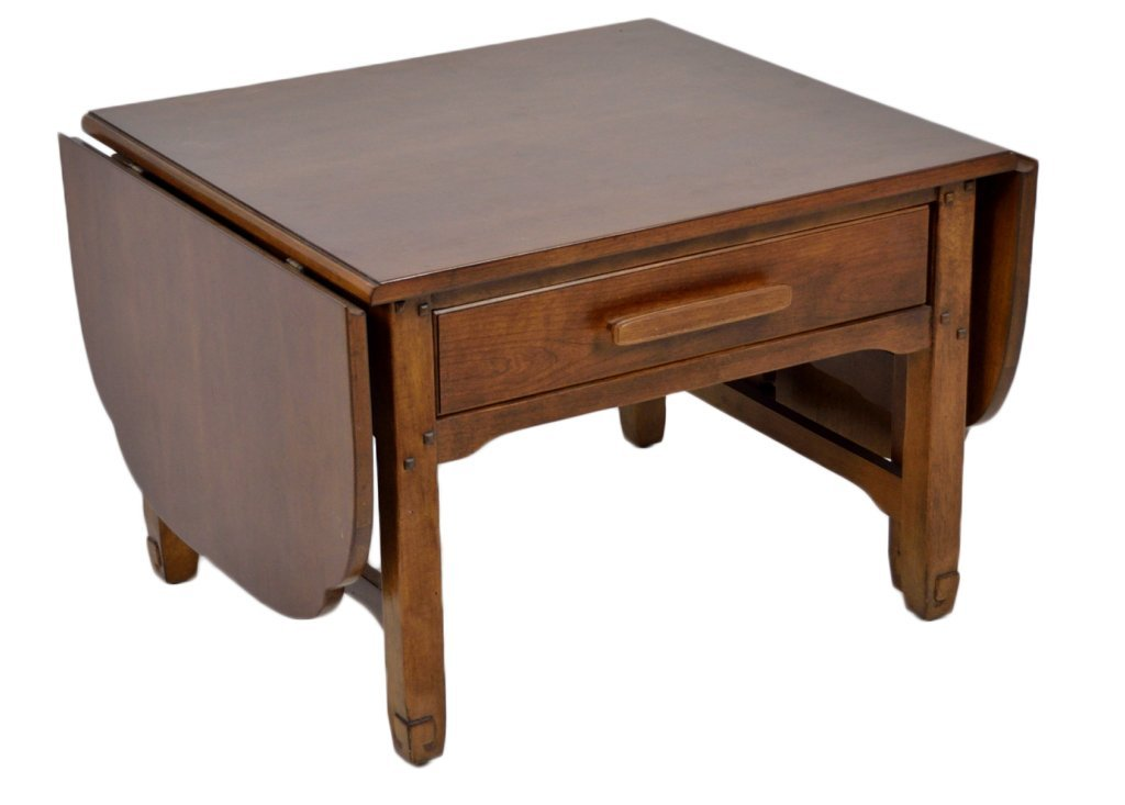 a small cherry drop leaf coffee table