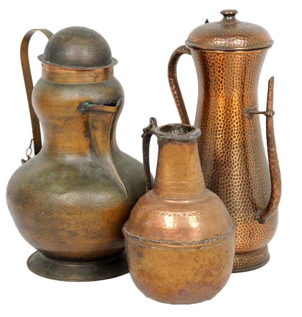 2: A GROUP OF THREE DECORATIVE COPPER EWERS