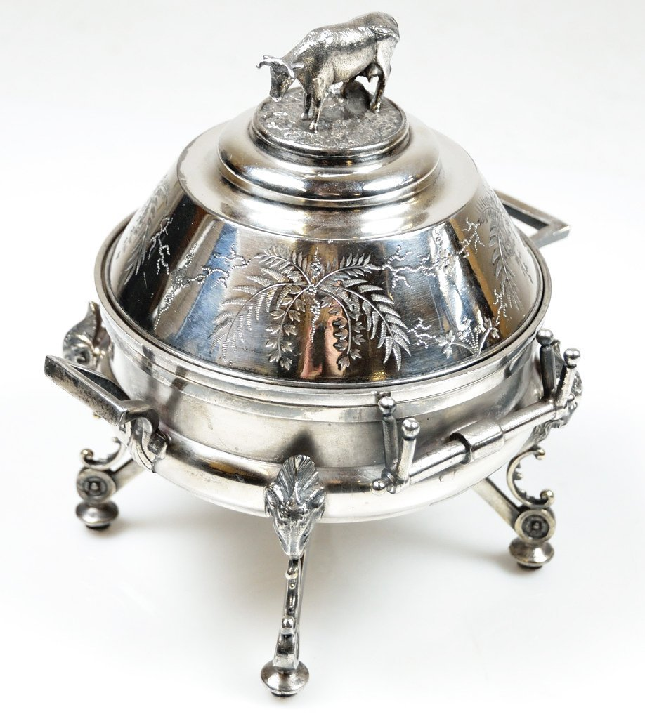 5: AN ANTIQUE MERIDEN SILVERPLATED FIGURAL COVERED BUTT