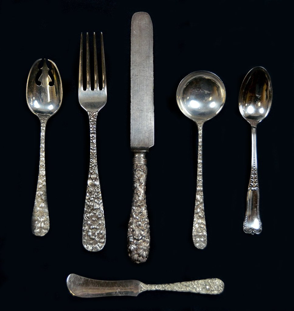 15: A GROUP OF 34 STIEFF AND KIRK REPOUSSÉ STERLING FLA