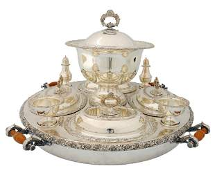 A LARGE SILVER PLATED SERVING CENTERPIECE WITH FITTI