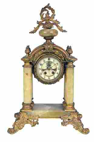 A BAROQUE STYLE GILT BRONZE AND ONYX MANTLE CLOCK L