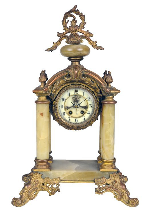 10: A BAROQUE STYLE GILT BRONZE AND ONYX MANTLE CLOCK L