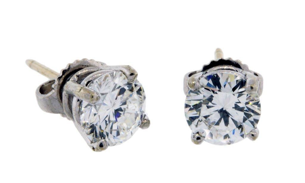 17: A PAIR OF DIAMOND BRILLIANT CUT EARRINGS SET IN 14K