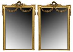 42: A PALATIAL PAIR OF LOUIS XVI STYLE GILT WOOD PIER M