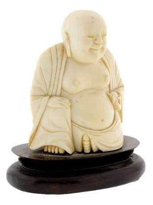 A CHINESE CARVED IVORY BUDDHA