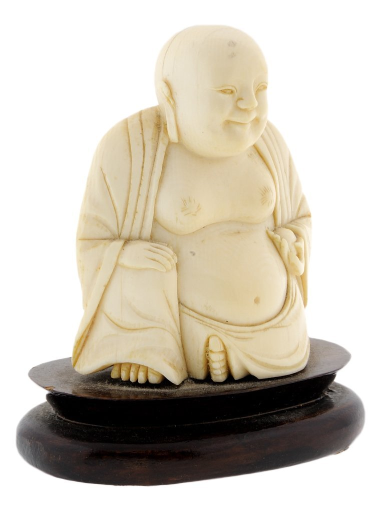 17: A CHINESE CARVED IVORY BUDDHA