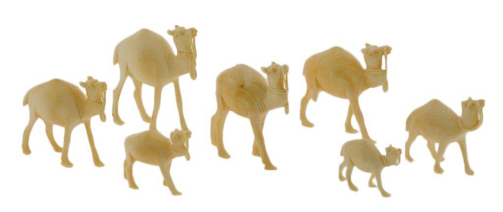 18: SEVEN MINIATURE IVORY CAMELS