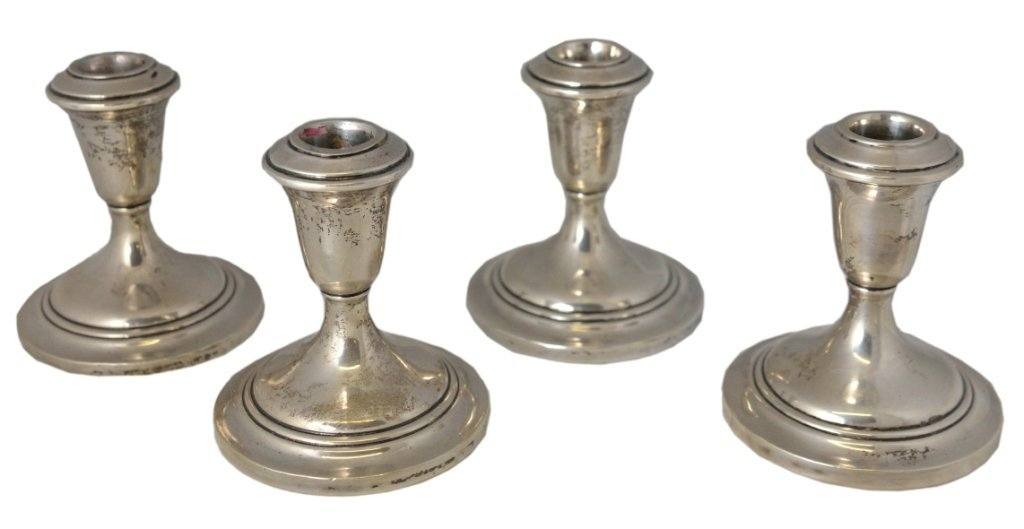 8: FOUR WEIGHTED STERLING CANDLESTICKS