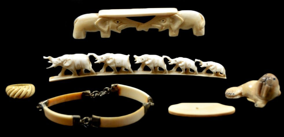22: SIX CARVED IVORY AND STONE PIECES