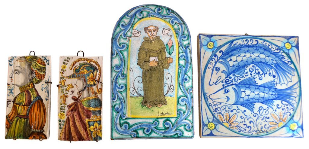 23: A GROUP OF FOUR ITALIAN DECORATED CERAMIC TILES