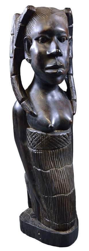 AN AFRICAN CARVED AND EBONIZED KNEELING FIGURE