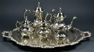 A VICTORIAN STYLE SIX PIECE SILVER PLATE VINTAGE TEA SE